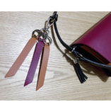 The camel and burgundy leather key ring